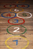 Round hopscotch numbers on wood floor Royalty Free Stock Photos