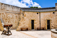 The Round House: Colonial Limestone and Stocks. FREMANTLE,WA,AUSTRALIA-NOVEMBER 19,2015: The Round House in Fremantle, Western Australia with punishment stocks Royalty Free Stock Image