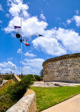 The Round House: Historic Site with Flag Array. FREMANTLE,WA,AUSTRALIA-NOVEMBER 19,2015: The Round House in Fremantle, Western Australia limestone heritage site Stock Image