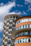 Round houses. Two round tall houses against a blue sky royalty free stock photo