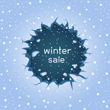 Round ice crack winter sale. Big round blue ice hole crack and falling large snow. Text winter sale lettering Royalty Free Stock Image