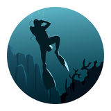 Round illustration of illustration of divers under water. Abstract round logo of illustration of scuba divers under water in dark blue tone Royalty Free Stock Photo