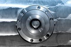 Round industrial metal detail. Blue toning. Round industrial metal detail on a metal plate. Front view. Blue toning royalty free stock photography