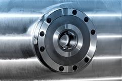 Round industrial metal detail. Blue toning. Round industrial metal detail on a metal plate. Side view. Blue toning stock photos