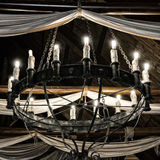 Round iron chandelier. Royalty Free Stock Photos