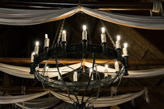 Round iron chandelier. Royalty Free Stock Image