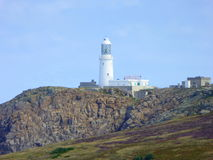 Lighthouse on top of cliff Royalty Free Stock Photos