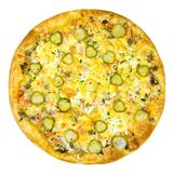 Round Italian pizza with ham, chicken, cucumbers and cheese stock images