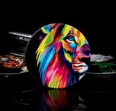 Round telescopic kickstands with Abstract lion head on black background. Round kickstand for smartphone with pictures on them. They are telescopic and pop twice royalty free stock image
