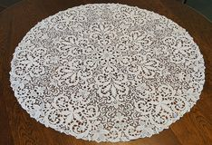 Tablecloth on the table. Round knitted tablecloth on the table Royalty Free Stock Photography