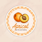 Round label, apricot jam on a sand background Royalty Free Stock Photography