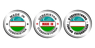 """Round labels """"Made in Uzbekistan"""" with flag. Round labels Made in Uzbekistan with flag Stock Image"""