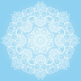 Round lace ornament  on blue. Royalty Free Stock Photo