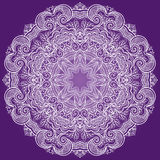 Round lace ornament isolated on purple. Stock Photos