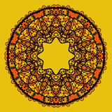 Round lace patterd mandala like design in yellow Stock Photos