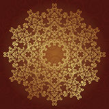 Round lace pattern in gold Stock Photos