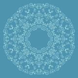 Round lacy pattern on blue background Royalty Free Stock Photo