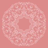 Round lacy pattern on pink background Royalty Free Stock Photography