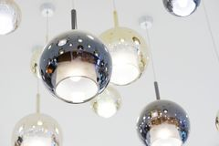 Round lamp are hanged on ceiling.  stock image