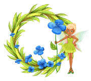 A round leafy border with a fairy holding a blue flower Stock Images