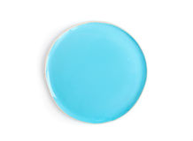 A round light blue glazed ceramic plate (dish) on a white backgr Stock Photos