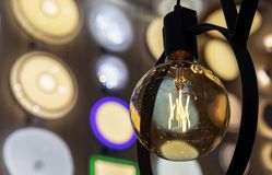 Round light bulb with dark glass in a loft style royalty free stock photography