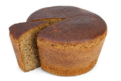 Round loaf of rye bread with piece cut. Isolated on the white background Royalty Free Stock Photos