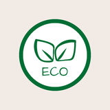 Round logo. The outline of the green leaves. Text ECO. Stock Photography