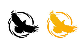 Round Logos with Raven. Logos in Orange and Black colors with Silhouette of Crow. Flying of Raven in Round Decorative Ring. Set of Vector Emblems  on White Royalty Free Stock Photos