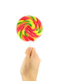 Round lollipop in hand Stock Images