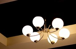 Round Luminous White Yellow Chandelier royalty free stock photo