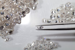 Round  and Marquise diamond shape with tweezers. Stock Photo
