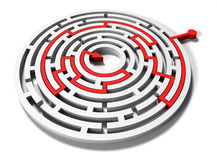 Round maze with red arrow in goal Stock Photo