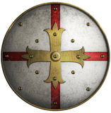 Round medieval shield with golden cross Stock Photo
