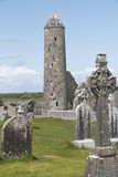 Round medieval tower still standing at Clonmacnoise Royalty Free Stock Photo