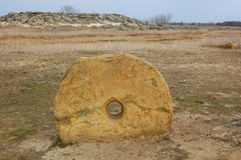 Round megalithic stone in the steppe. Stock Images