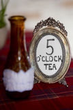 Round metal frame for picture with inscription 5 o'clock tea Stock Photo