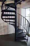 Round metal indoor staircase in a corner Stock Images