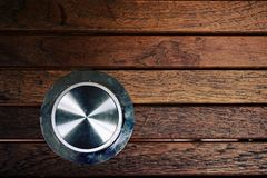 Round metal on lineup wood board Stock Photography