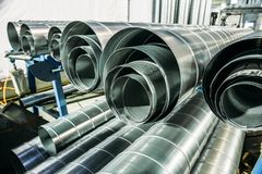 Round metal or steel or galvanized iron tubes or pipes in metalworking workshop stock image