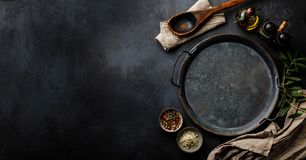 Round metal Tray and Spices on dark concrete backdrop Surface copy space stock images