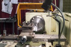 The round metal workpiece is machined on a lathe. Royalty Free Stock Photo