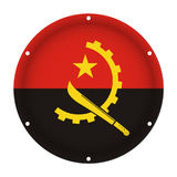 Round metallic flag of Angola with screw holes. Round metallic flag of Angola with six screw holes in front of a white background Stock Photography