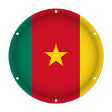 Round metallic flag of Cameroon with holes Royalty Free Stock Image