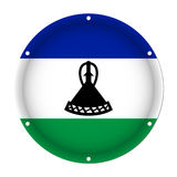 Round metallic flag of Lesotho with screw holes Royalty Free Stock Images