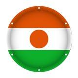Round metallic flag of Niger with screw holes Stock Photo