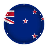 Round metallic flag with holes - New Zealand Stock Image