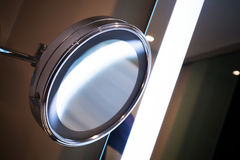 Round mirror with bright illumination Royalty Free Stock Images