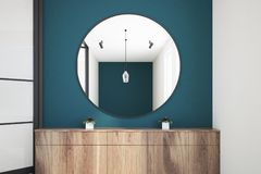 Blue living room, mirror and chest of drawers. Round mirror hanging above a wooden chest of drawers in a blue green wall living room with loft windows. 3d Stock Image