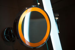 Round mirror with light in the bathroom Royalty Free Stock Images